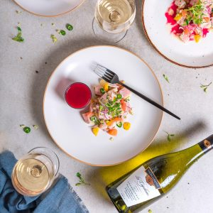 White fish ceviche with citrus and yellow pepper and beet dressing